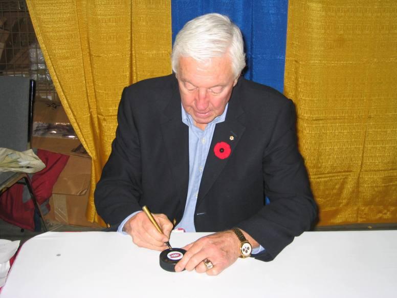 Jean Beliveau signing autograph